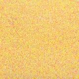 Текстура золота сияющая, желтые sequins с предпосылкой нерезкости Стоковое Фото