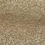 Текстура золота сияющая, желтые sequins с предпосылкой нерезкости Стоковые Изображения RF