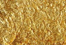 текстура золота фольги предпосылки глянцеватая Стоковая Фотография