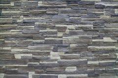 Текстура - искусственное façade декоративного камня Текстура предпосылки каменной стены декоративного серого цвета грубая Стоковые Изображения
