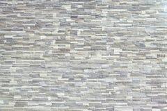 Текстура - искусственное façade декоративного камня Текстура предпосылки каменной стены декоративного серого цвета грубая Стоковая Фотография