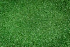 Текстура искусственной предпосылки поля травы Стоковые Фотографии RF