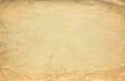 Текстура или предпосылка Grunge коричневые старые бумажные с виньеткой Стоковые Фото
