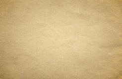 Текстура или предпосылка Grunge коричневые старые бумажные с виньеткой Стоковое Изображение