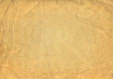 Текстура или предпосылка Grunge коричневые старые бумажные с виньеткой Стоковое фото RF