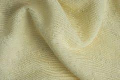 Текстура и предпосылка желтой ткани хлопка и капка Стоковые Изображения