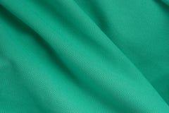 Текстура и предпосылка зеленой ткани полиэстера настолько красивой Стоковые Фото