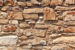 Текстура - кирпичная стена песчаника стоковое фото
