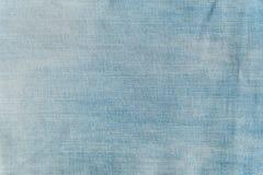 Текстура конца-вверх предпосылки голубых джинсов Стоковое Изображение