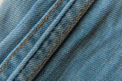 Текстура конца-вверх предпосылки голубых джинсов Стоковая Фотография