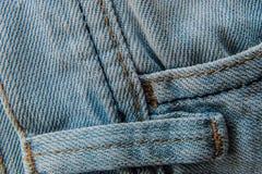 Текстура конца-вверх предпосылки голубых джинсов Стоковое Фото