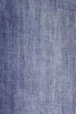 Текстура конца ткани голубых джинсов вверх Стоковые Изображения RF