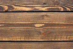Текстура коричневого цвета деревянных доск предпосылки яркая Стоковое Изображение