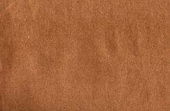 текстура коричневой бумаги предпосылки Стоковые Фотографии RF