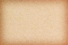 текстура коричневой бумаги предпосылки Стоковое фото RF