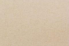 текстура коричневой бумаги предпосылки Стоковая Фотография