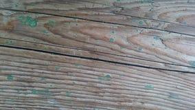 Текстура коричневой древесины которая формирует третью картину Стоковые Изображения