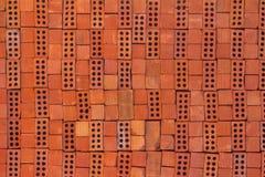 Текстура красного кирпича штабелированного как предпосылка стоковое фото