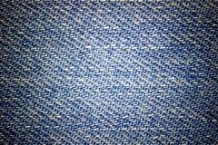 Текстура крупного плана голубых джинсов Стоковые Фото