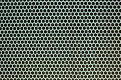 Текстура металла с отверстиями польза текстуры диктора решетки предпосылки Стоковые Фото