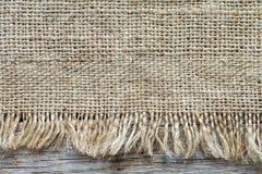 Текстура мешка реднины и деревянная предпосылка планки Стоковые Изображения RF