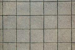 Текстура мостоваой серо Плитка Справочная информация квадрат Картина стоковая фотография