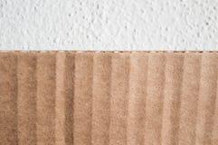Текстура наслоенной коричневой стороны картона Сложенную картонную коробку ag Стоковое Изображение RF