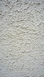 Текстура на вертикали стены белого цемента заканчивая Стоковая Фотография