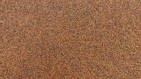 Текстура небольшого гранита Брауна каменная стоковое фото rf