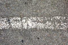 Текстура дорожного покрытия с линией краской Стоковые Изображения