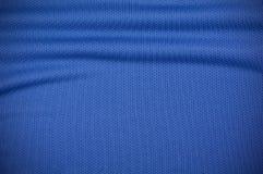 Текстура одежды рубашки jersey спорта в сини Стоковые Фото