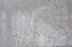 Текстура падения дождя на стеклянной влажной прозрачной предпосылке Стоковое фото RF