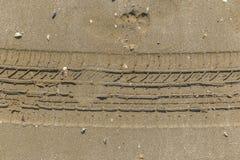 Текстура песка пляжа после дождя Стоковое Фото