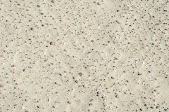 Текстура песка с камнями Стоковые Изображения