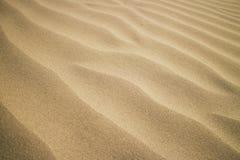 текстура песка dof предпосылки отмелая Стоковые Изображения RF