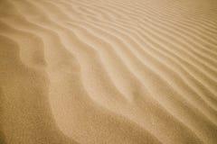 текстура песка dof предпосылки отмелая Стоковое Изображение
