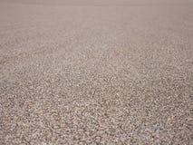текстура песка dof предпосылки отмелая Стоковые Изображения