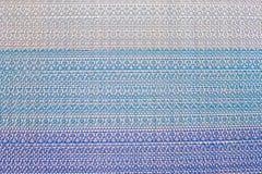 Текстура пестротканого сплетенного ковра стоковое фото