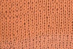 текстура пинка knit ткани предпосылки шерстяная Стоковая Фотография RF