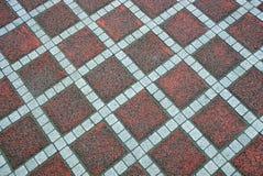 Текстура покрашенного квадратного старого вымощая сляба на дороге Стоковые Изображения RF