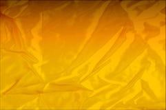 Текстура, предпосылка, картина Тени красного, желтого золота шелка fa Стоковая Фотография RF