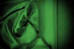 Текстура, предпосылка, картина Шелк ткани темные ые-зелен выразьте стоковое фото
