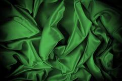 Текстура, предпосылка, картина Шелк ткани темные ые-зелен выразьте стоковые изображения