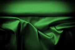 Текстура, предпосылка, картина Шелк ткани темные ые-зелен выразьте стоковое изображение