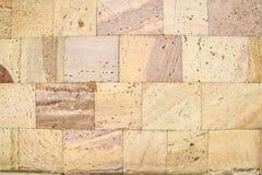 Текстура предпосылки каменной стены кирпича туфа стоковые фото