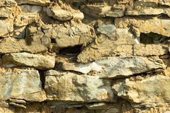Текстура предпосылки, каменные бутоны, известняк, базальт, булыжник, гранит, камешки, шифер, песчаник клала стену или в загородке стоковые фото
