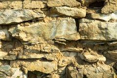 Текстура предпосылки, каменные бутоны, известняк, базальт, булыжник, гранит, камешки, шифер, песчаник клала стену или в загородке стоковое фото rf