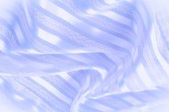 Текстура предпосылки, картина пастельно Голубая silk ткань с lig стоковая фотография