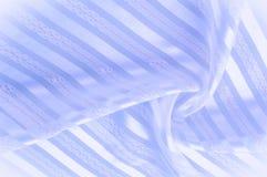 Текстура предпосылки, картина пастельно Голубая silk ткань с lig стоковое фото