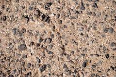 Текстура предпосылки облицовывает черноты конца-вверх песка гранита летний день раковин желтого цвета конкретной серый Стоковые Фото